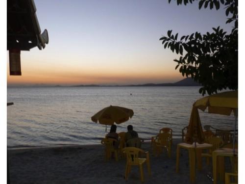 A couple having dinner at Hejo's on the beach at Lagoa de Araruama in Sao Pedro da Aldeia.