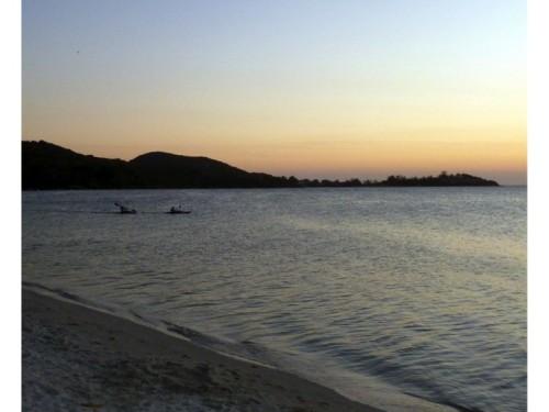 Kayakers at sunset on Lagoa de Araruman in Sao Pefro da Aldeia